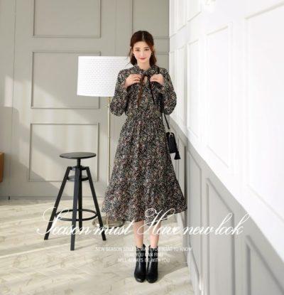 Cao gầy đừng ngại mặc váy dài đen hoa dài tay thắt nơ nhé, đảm bảo xinh