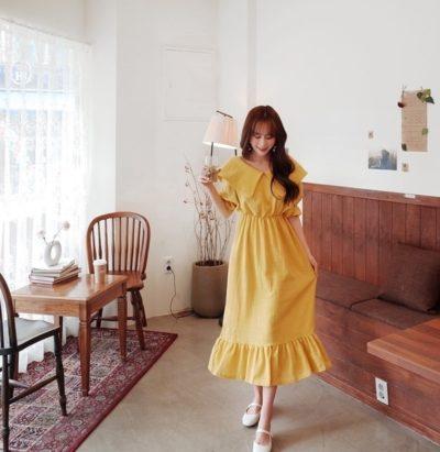 Váy cổ thuyền màu vàng dài, nàng nào vai to mặc được hết luôn