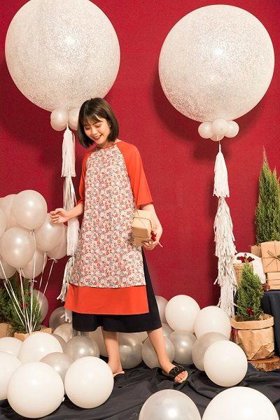 Áo dài 2 lớp tà phong cách hoài cổ phối cùng chân váy xòe.
