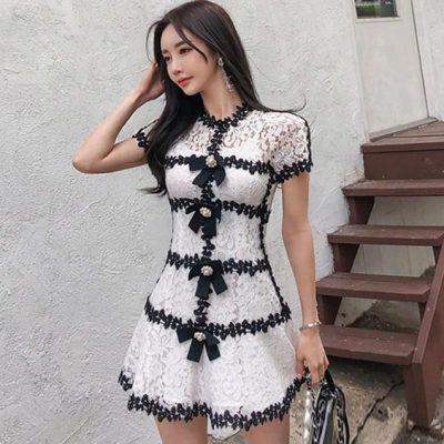 Đầm ren trắng phối đen tay ngắn