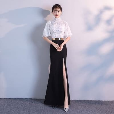 Đầm dạ hội trên trắng dưới đen xẻ cao