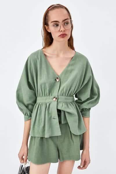 Dáng áo blouse cổ chữ V nhấn eo