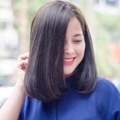 Kiểu tóc ngang vai cho mặt tròn trán cao